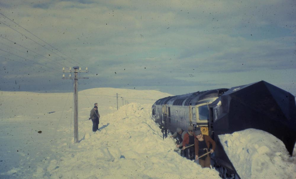 A Pair Of Snowploughs And Their Attending Class 26 S Are